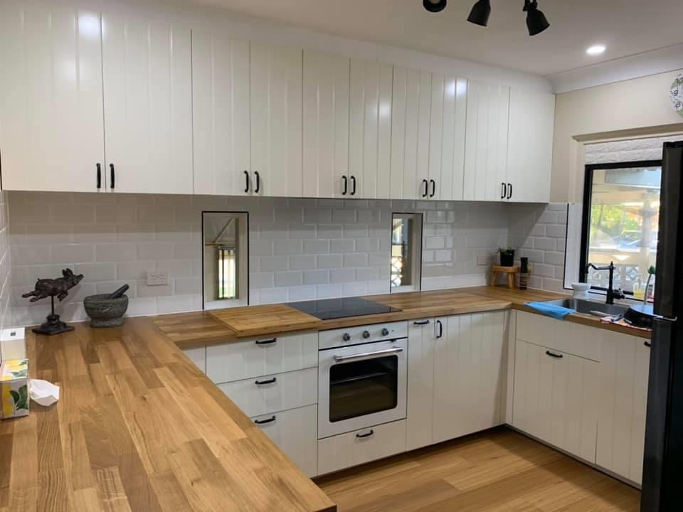 white flat pack kitchen with timber benchtop