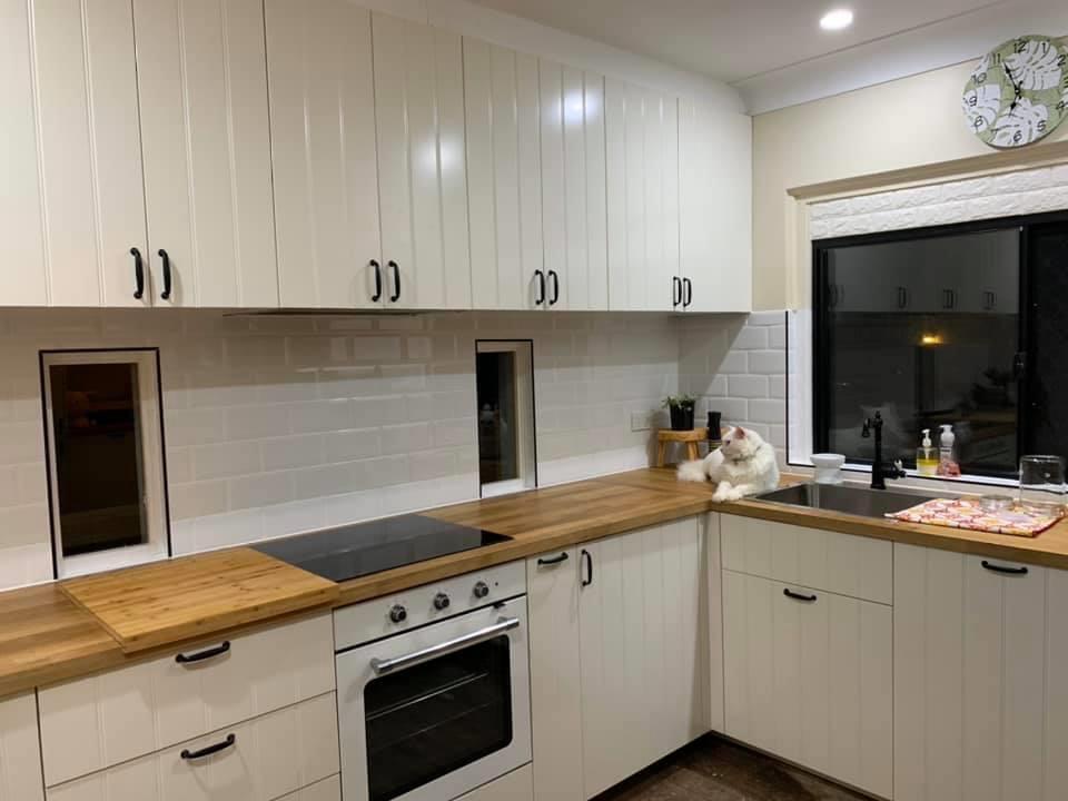 white kitchen at night time