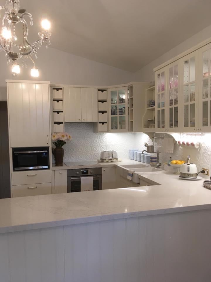 cream kitchen with grooved doors