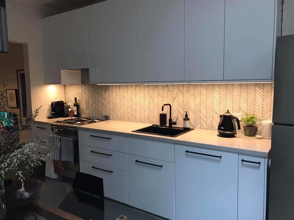 modern white kitchen with big handles